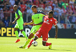 MAINZ, GERMANY - Sunday, August 7, 2016: Liverpool's Joel Matip in action against FSV Mainz 05's Jhon Córdoba during a pre-season friendly match at the Opel Arena. (Pic by David Rawcliffe/Propaganda)