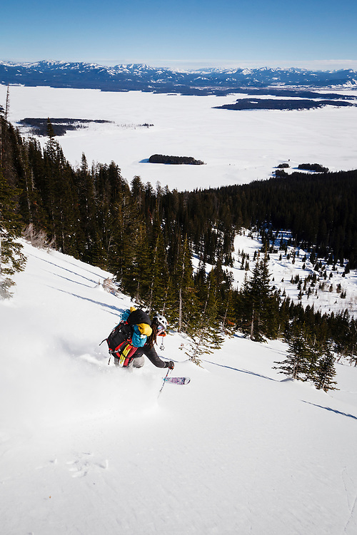 Ryan Mertaugh finds skiing a pocket of powder with a 50 lb pack fun on Mt Moran, Grand Teton National Park.