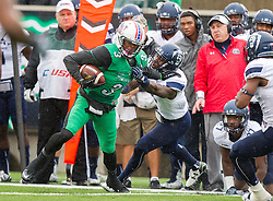 Oct 3, 2015; Huntington, WV, USA; Marshall Thundering Herd wide receiver Davonte Allen shakes off a tackle during the second quarter against the Old Dominion Monarchs at Joan C. Edwards Stadium. Mandatory Credit: Ben Queen-USA TODAY Sports