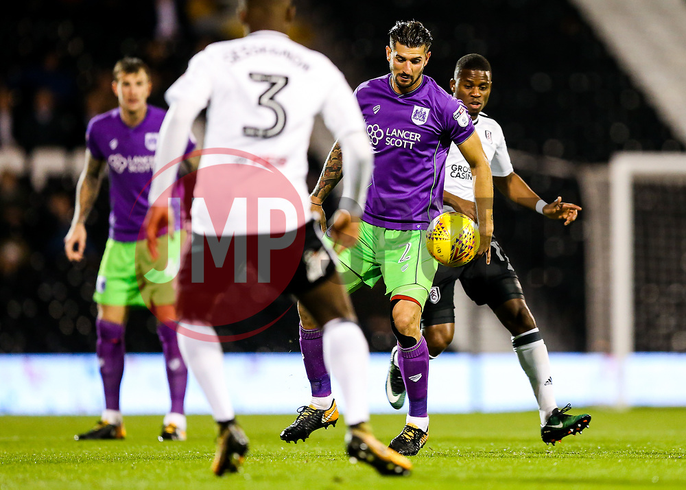Eros Pisano of Bristol City is injured as he is challenged by Floyd Ayite of Fulham - Rogan/JMP - 31/10/2017 - Craven Cottage - London, England - Fulham FC v Bristol City - Sky Bet Championship.