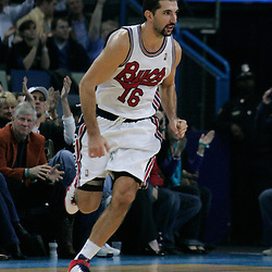 28 January 2009:  New Orleans Hornets forward Peja Stojakovic (16) runs back to defend after hitting a three pointer during a 94-81 win by the New Orleans Hornets over the Denver Nuggets at the New Orleans Arena in New Orleans, LA. The Hornets wore special throwback uniforms of the former ABA franchise the New Orleans Buccaneers for the game as they honored the Bucs franchise as a part of the NBA's Hardwood Classics series. .