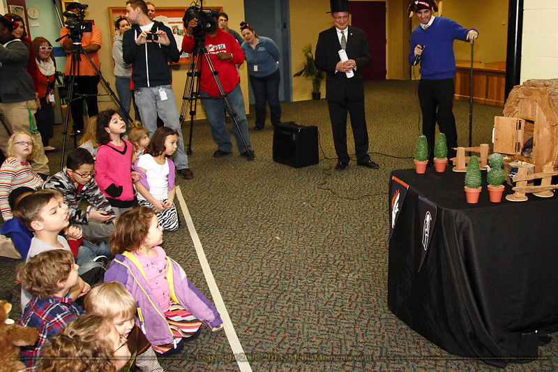 The crowd watches as Rosie begins to come out of her weather hutch in the education center at the Boonshoft Musum of Discovery in Dayton, Sunday, February 2, 2014.  This is the first time that Rosie, the Discovery Zoo's resident groundhog and part time weather predictor, has predicted the outcome of a major football game.