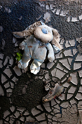 03 November, 2005.  New Orleans, Louisiana. Post Katrina.   <br /> A childs' toy and shoe lie inside a flood ravaged trailer at the Oak Grove trailer park in Saint Bernard parish just south of New Orleans. Hurricane Katrina caused a 20ft tidal surge to sweep over the land, devastating much of the parish.<br /> Photo; ©Charlie Varley/varleypix.com
