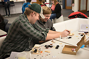 Students and their siblings participate in a remote control car building activity at the CoLab in Alden Library during Sibs Weekend on Feb. 2, 2019. Photo by Hannah Ruhoff