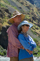 Portrait of couple taken while rafting Hell's Canyon of the Snake River, ID / OR. Hell's Canyon is the deepest canyon in North America.