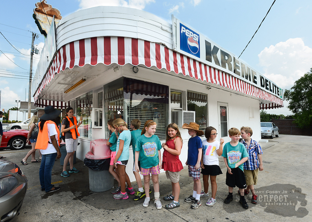 Photo by Gary Cosby Jr.   Kids from the Athens First Baptist Church summer program enjoy an ice cream outing at Kreme Delite on Washington St. Tuesday afternoon.