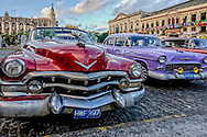 Cadillac in front of the Capitolio at sunset in Havana, Cuba.