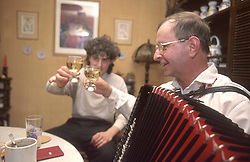 CZECH REPUBLIC MORAVIA BANOV APR98 - Jiri Chovanec (R) clinks glasses with his host during his musical visit at their home during Easter. During Easter, folklore dress, music and mutual visits are part of the customary traditional celebrations in Moravia.  jre/Photo by Jiri Rezac<br />