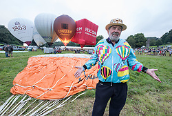 © Licensed to London News Pictures. 12/08/2016. Bristol, UK. Bristol International Balloon Fiesta 2016. TONY OLPIN age 76 is not flying today as Friday morning's planned mass ascent is called off due to strong winds at flying height. Tony first flew in a balloon in 1974 and was at the first Bristol Balloon Fiesta in 1979. The Bristol International Balloon Fiesta is Europe's largest ballooning event and takes place from Thursday 11th August – Sunday 14th August, attracting half a million people over four days. This year 150 hot air balloons will attend, taking off in mass ascents at dawn and dusk. On Thursday and Saturday evenings, 30 balloons will tether in the main arena and light up in sequence to music for the famous Night Glows. Photo credit : Simon Chapman/LNP