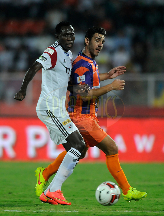 Kondwani Mtonga of NorthEast United FC and Kostas Katsouranis of FC Pune City fight for the ball during match 20 of the Hero Indian Super League between FC Pune City and NorthEast United FC held at the Shree Shiv Chhatrapati Sports Complex Stadium, Pune, India on the 3rd November 2014.<br /> <br /> Photo by:  Pal Pillai/ ISL/ SPORTZPICS