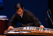 "Koto musician Mitsuki Dazai performs at the Portland Taiko concert ""Three: 3 conversations with Taiko"", Winningstad Theatre, Portland Center for the Performing Arts, Portland, Oregon."