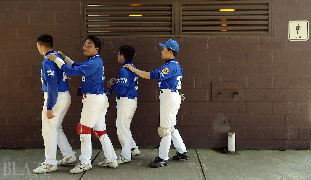 Member of the Taiwan Homerun return from a bathroom stop at the 2006 World Series of Beep Baseball in Strongsville, Ohio. Most of the team members traveled together in groups when needing to do basic daily tasks..Photo by Ken Blaze.