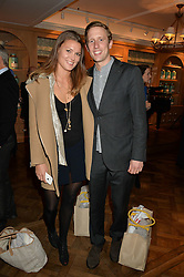 GEORGE FROST and EMMA BORGERHOFF MULDER at a party to celebrate the publication of 'Let's Eat meat' by Tom Parker Bowles held at Fortnum & Mason, Piccadilly, London on 21st October 2014.