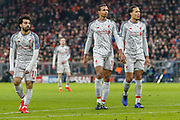 Liverpool forward Mohamed Salah (11), Liverpool defender Joel Matip (32) and Liverpool defender Virgil van Dijk (4)  during the Champions League match between Bayern Munich and Liverpool at the Allianz Arena, Munich, Germany, on 13 March 2019.