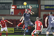 5 George Ray for Crewe Alexander wins the ariel challenge with 16 Michael Bostwick for Lincoln City during the EFL Sky Bet League 2 match between Crewe Alexandra and Lincoln City at Alexandra Stadium, Crewe, England on 26 December 2018.