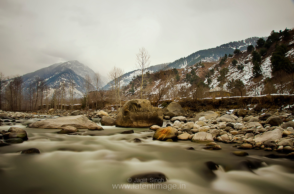 Beas River at Manali. On the beak ground, the Himalayan range. On a cloudy day. <br />