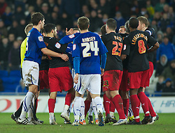 CARDIFF, WALES - Tuesday, February 1, 2011: Tempers fly as Cardiff City's Michael Chopra and Reading's Jobi McAnuff exchange words after McAnuff had kicked the ball away during the Football League Championship match at the Cardiff City Stadium. (Photo by Gareth Davies/Propaganda)