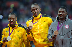 Usain Bolt with his 100m Gold medal at the London 2012 Olympics,  Monday, 6th  August 2012  Photo by:  i-Images