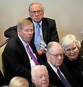 Political leaders including U.S. Sen. Johnny Isakson, R-Ga., center, former U.S. Sen. Sam Nunn, D-Ga., right, and former governors President Jimmy Carter and Joe Frank Harris attend a memorial service for Georgia Gov. Carl Sanders at Second Ponce de Leon Baptist Church on Saturday, Nov. 22, 2014, in Atlanta.  Photo by David Tulis