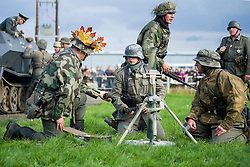 Re-enactors portrayiing panzer grenadiers prepare a replica 81mm mortar during a battle battle re-enactment in on Pickering Showground<br />