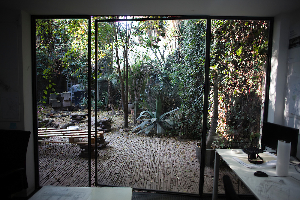 The courtyard is seen through the windows of the office of Mauricio Rocha in Mexico City.