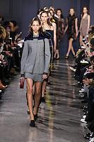 Yasmin Wijnaldum walks the runway wearing Jason Wu Fall 2016, Hair by Paul Hanlon for Morocconoil, Makeup by Yadim for Maybelline, shot by Thomas Concordia during New York Fashion Week on February 12, 2016