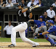 CHICAGO - JUNE 21:  Alex Rios #51 of the Chicago White Sox hits a double in the third inning during the game against the Chicago Cubs on June 21, 2011 at U.S. Cellular Field in Chicago, Illinois.  (Photo by Ron Vesely)  Subject:  Alex Rios