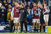 Jack Grealish (Capt) (Aston Villa) shares a smile with Paul Trollope, Assistant Manager of Brighton & Hove Albion FC following the final whistle after the Premier League match between Brighton and Hove Albion and Aston Villa at the American Express Community Stadium, Brighton and Hove, England on 18 January 2020.