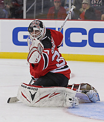 Oct 8; Newark, NJ, USA; New Jersey Devils goaltender Martin Brodeur (30) makes a glove save during the second period of their game against the New Jersey Devils at the Prudential Center.
