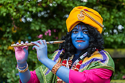 © Licensed to London News Pictures. 05/09/2015. Watford, UK. Local schoolboy, Paavan, dresses up for the day as Lord Krishna at the biggest Janmashtami festival outside of India at the Bhaktivedanta Manor Hare Krishna Temple in Watford, Hertfordshire.  The event celebrates the birth of Lord Krishna and the festival  includes music, dance, food, dramas and more. Photo credit : Stephen Chung/LNP