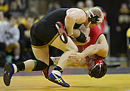 January 22 2010: Iowa's Luke Lofthouse flips Ohio State's Peter Capone during the 197-pound bout an NCAA wrestling dual at Carver-Hawkeye Arena in Iowa City, Iowa on January 22, 2010. Lofthouse defeated Capone 6-4 and Iowa defeated Ohio State 33-3..