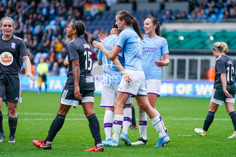 Manchester City Women forward Lee Geum-min (17) scores a goal and celebrates with team mates to make the score 3-0 during the FA Women's Super League match between Manchester City Women and BIrmingham City Women at the Sport City Academy Stadium, Manchester, United Kingdom on 12 October 2019.