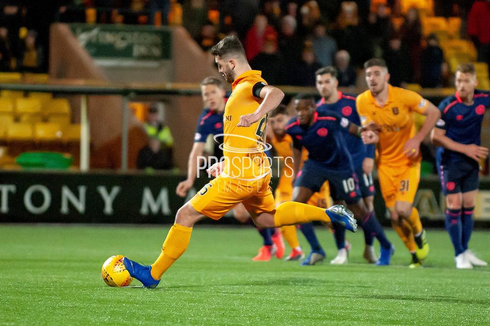 Craig Halkett (#26) of Livingston FC scores a penalty during the Ladbrokes Scottish Premiership match between Livingston FC and Heart of Midlothian FC at the Tony Macaroni Arena, Livingston, Scotland on 14 December 2018.