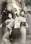 portrait of two woman in a tradtional dance pose  Japan ca 1930s