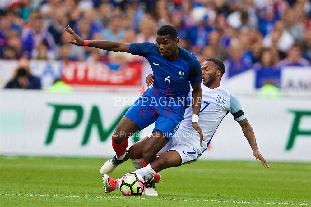 PARIS, FRANCE - Tuesday, June 13, 2017: France's Paul Pogba and England's Raheem Sterling during an international friendly match at the Stade de France. (Pic by David Rawcliffe/Propaganda)
