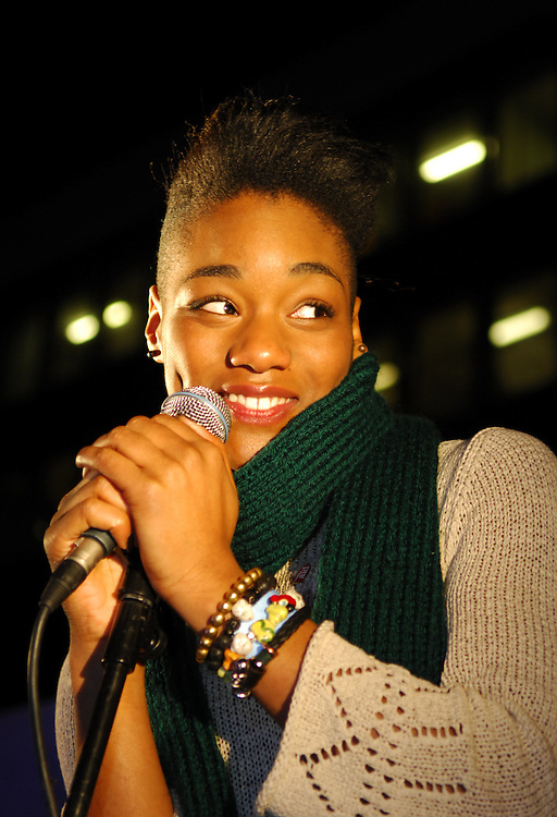 X factor contestant, Rachel Adedeji, singing at the Natural History Museum ice rink on behalf of Christian Aid, December 2009
