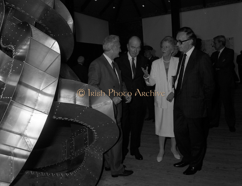 19/08/1988<br /> 08/19/1988<br /> 19 August 1988<br /> Opening of ROSC '88 at the Guinness Hop Store, Dublin. Patrick Murphy, ROSC Chairman, ( left) discusses an exhibit with President Patrick Hillery (second from left) who officially opened the exhibition;  Maeve Hillery and  Harry Byrne (right)  Financial Director, Guinness Ireland.