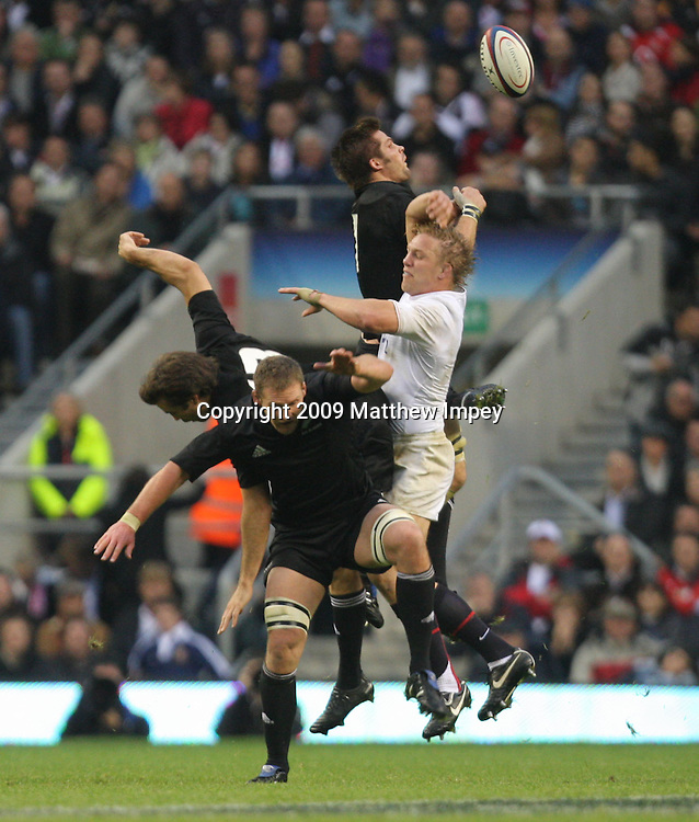 Lewis Moody of England competes for the ball at the re-satrt with Richie McCaw, Kieran Read and Conrad Smith of New Zealand. England v New Zealand, International Rugby Union, Twickenham, 21/11/2009 © Matthew Impey/Wiredphotos.co.uk. tel: 07789 130 347 email: matt@wiredphotos.co.uk