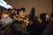 Fans watch Major League Baseball team the Chicago Cubs play in game seven of the World Series on television through bar windows near Wrigley Field in Chicago on November 2, 2016. The Chicago Cubs went on to defeat the Cleveland Indians in extra innings for their first World Series win since 1908.