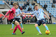 Coventry City defender Chris Stokes plays the ball forward during the Sky Bet League 1 match between Coventry City and Peterborough United at the Ricoh Arena, Coventry, England on 31 October 2015. Photo by Alan Franklin.