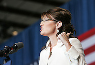 U.S. Republican vice presidential nominee Governor Sarah Palin motions with her hand as she speaks to the crowd at a campaign rally in Cedar Rapids, Iowa, September 18, 2008.