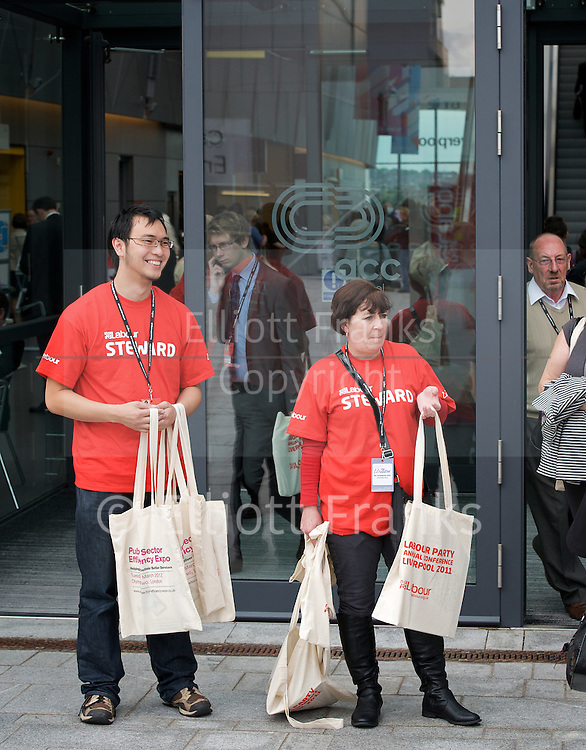 Labour Annual Conference<br /> at the Echo Arena &amp; BT Convention Centre, Liverpool, Great Britain <br /> 25th to 28th September 2011 <br /> <br /> Stewards handing out bags at the entrance<br /> <br /> Photograph by Elliott Franks