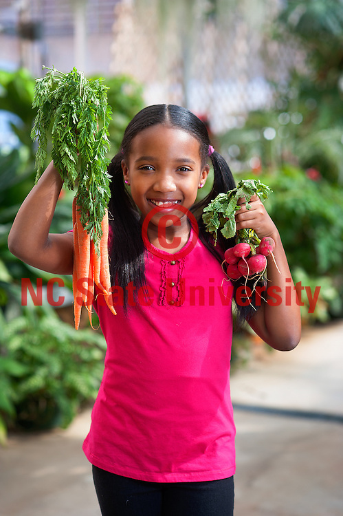 agriculture, carrot, girl, green house, hunt microsite, raddish, red, sustainable, vegtable. Photo by Marc Hall