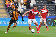 Bristol City defender Bailey Wright (5) and Hull City forward Fraizer Campbell (25) during the EFL Sky Bet Championship match between Hull City and Bristol City at the KCOM Stadium, Kingston upon Hull, England on 5 May 2019.
