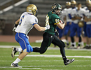 Kennedy's Alexander Hillyer (28) tries to get around Wahlert's Riley McCarron (6) during the first half of the game between Cedar Rapids Kennedy and Dubuque Wahlert at Kingston Stadium in Cedar Rapids on Friday night, October 21, 2011.