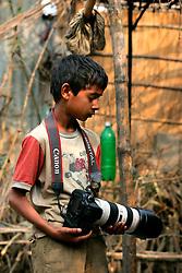BANGLADESH SIRAJGANJ RADHUNIBARI 30JAN07 - Young Bangladeshi boy holds a professional Canon EOS digital camera in a village near the Jamuna river area, traditionally prone to flooding during the Monsoon season...jre/Photo by Jiri Rezac..© Jiri Rezac 2007..Contact: +44 (0) 7050 110 417.Mobile:  +44 (0) 7801 337 683.Office:  +44 (0) 20 8968 9635..Email:   jiri@jirirezac.com.Web:    www.jirirezac.com..© All images Jiri Rezac 2007 - All rights reserved.