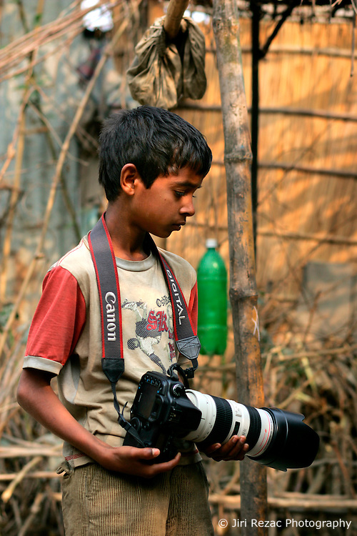 BANGLADESH SIRAJGANJ RADHUNIBARI 30JAN07 - Young Bangladeshi boy holds a professional Canon EOS digital camera in a village near the Jamuna river area, traditionally prone to flooding during the Monsoon season...jre/Photo by Jiri Rezac..© Jiri Rezac 2007..Contact: +44 (0) 7050 110 417.Mobile:  +44 (0) 7801 337 683.Office:  +44 (0) 20 8968 9635..Email:   jiri@jirirezac.com.Web:    www.jirirezac.com..© All images Jiri Rezac 2007 - All rights reserved.