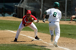 21 April 2007:  Mike Berry hustles to first after a dropped third strike, but the catcher recovers and the ball gets to Chris Sajdak ahead of Berry. Carthage College loses the first game of a double header by a score of 5-2 against the Illinois Wesleyan Titans.