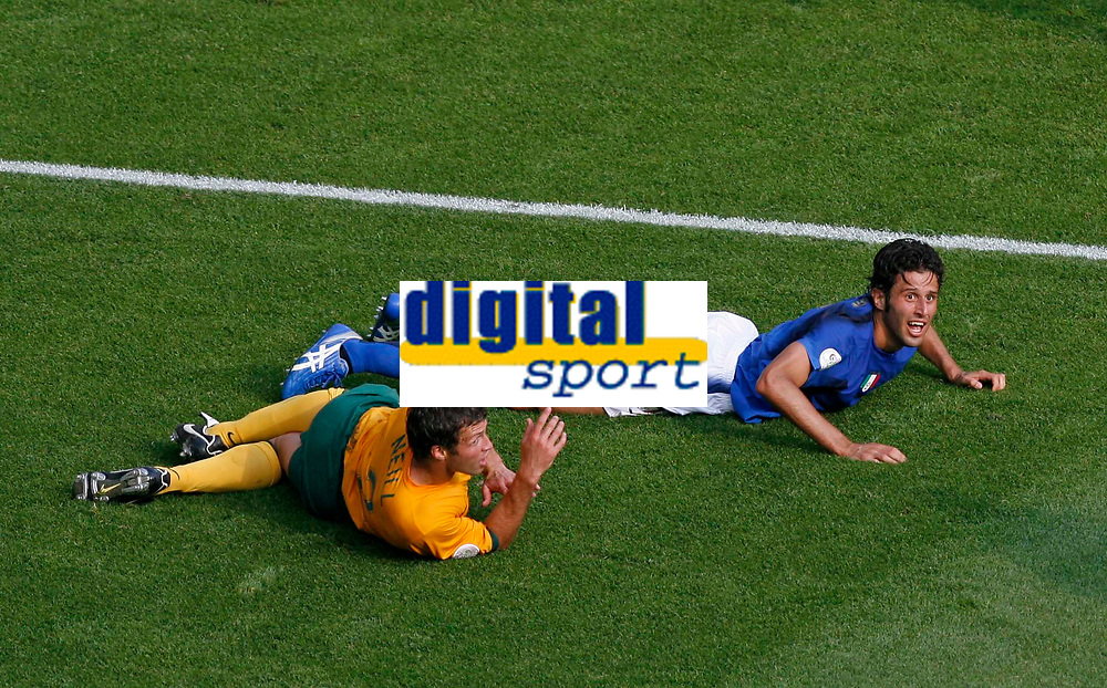 Photo: Glyn Thomas.<br />Italy v Australia. 2nd Round, FIFA World Cup 2006. 26/06/2006.<br /> Australia's Lucas Neill (L) brings down Italy's Fabio Grosso for a last-minute penalty.
