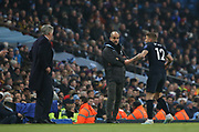 Everton defender Lucas Digne (12) speaks with Everton manager Carlo Ancelotti during the Premier League match between Manchester City and Everton at the Etihad Stadium, Manchester, England on 1 January 2020.